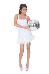 Woman in party dress holding disco ball