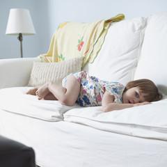 """""""USA, California, San Francisco, girl (2-3) lying on sofa"""""""