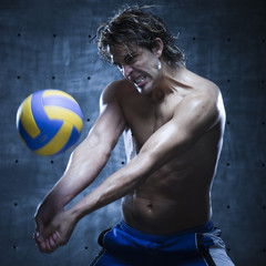 Studio shot of volleyball player playing
