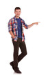 young man pointing towards something