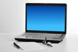 laptop isolated white screen with notepad, pen and glass