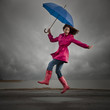 """USA, Utah, Orem, woman with umbrella jumping under overcast sky"""