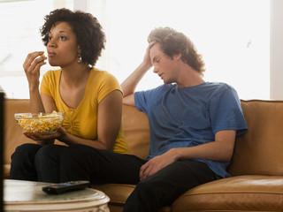 """USA, Utah, Provo, couple sitting on sofa"""