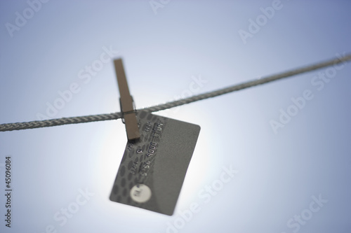 Credit card hanging on washing line