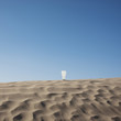"""USA, Utah, Little Sahara, glass of ice cold water in desert"""