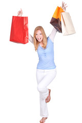 Excited woman jumping with shopping bags