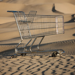 """USA, Utah, Little Sahara, abandoned shopping cart on desert"""