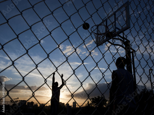 """USA, Utah, Salt Lake City, two young men playing street basketball"""