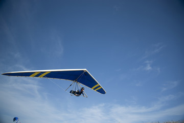 """USA, Utah, Lehi, young man hang gliding, low angle view"""