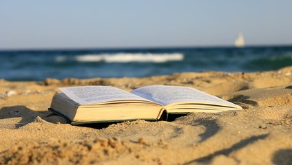 Book of sand on the beach