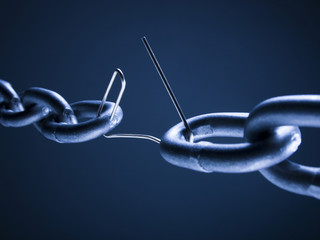 Chain linked with broken paper clip against blue background