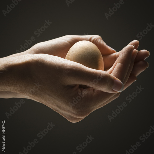 Egg in young woman's hands