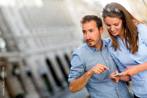 Tourists finding a location on their phone