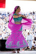 """USA, Utah, Spanish Fork, mid adult dancer in traditional clothing performing on stage"""