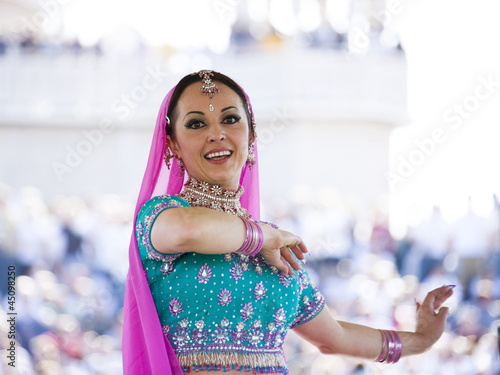 """USA, Utah, Spanish Fork, portrait of mid adult dancer in traditional clothing performing on stage"""