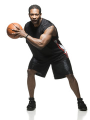 Mid adult man holding basketball in air, portrait