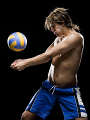 Young man receiving volleyball