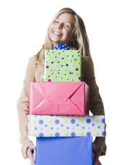 """Girl (10--11) holding a stack of presents, portrait"""