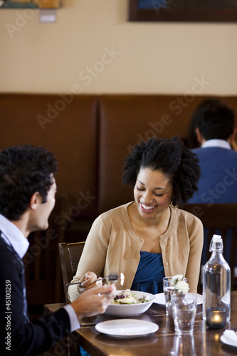 """USA, Utah, Orem, couple eating in restaurant"""