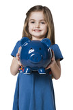 Studio portrait of girl (4-5) holding piggy bank