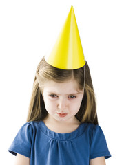 Studio portrait of girl (4-5) wearing party hat