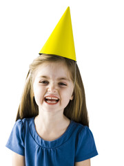 Studio portrait of girl (4-5) wearing party hat and laughing