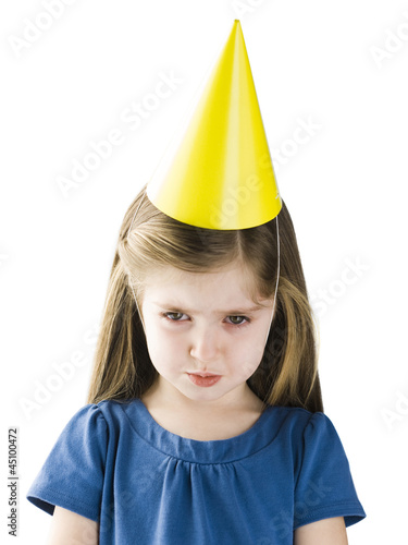 Studio portrait of girl (4-5) wearing party hat