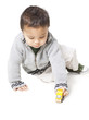 Studio shot of boy (18-23 months) playing with toy car