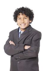 Studio portrait of boy (8-9) wearing suit