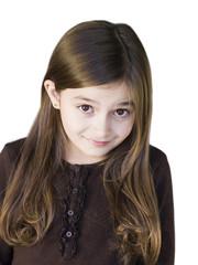 Studio portrait of girl (8-9) smiling
