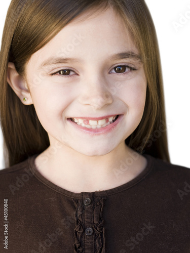 Studio portrait of girl (8-9) smiling