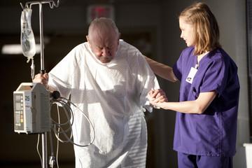 """USA, Utah, Provo, female nurse helping senior man in hospital"""