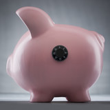 Studio shot of piggy bank with combination lock