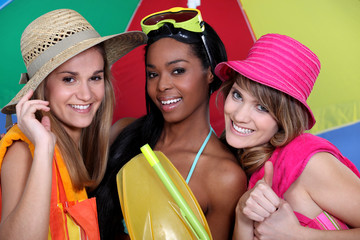 Three female friends with beachwear