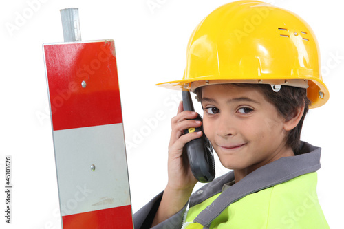 Child with yellow helmet
