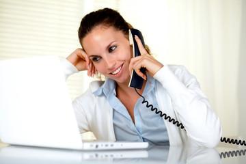 Smiling female conversing on phone