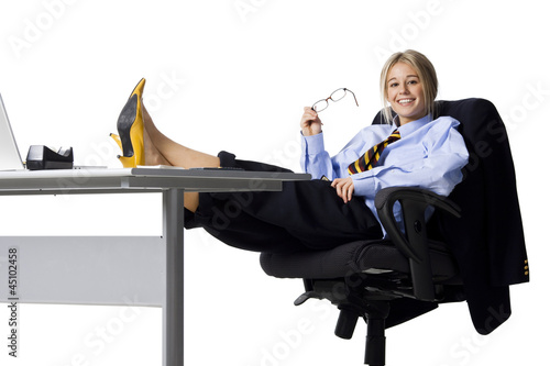 Studio portrait of businesswoman relaxing at desk