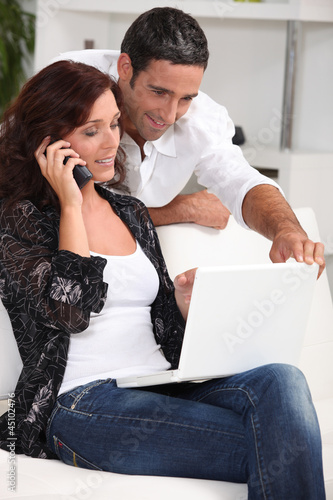 Couple with computer and phone