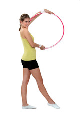 Woman displaying hula-hoop
