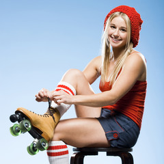 Portrait of young woman wearing roller skates
