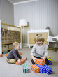 """USA, Utah, Provo, Two boys (18-23 months,2-3) playing with building blocks"""