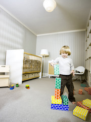 """USA, Utah, Provo, Boy (2-3) playing with building blocks"""