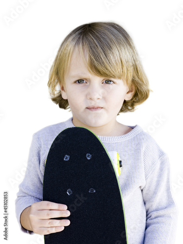 """USA, Utah, Provo, Portrait of boy (2-3) holding skateboard"""