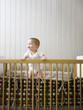 """USA, Utah, Provo, Baby boy (18-23 months) standing in crib"""
