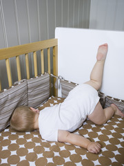 """USA, Utah, Provo, Baby boy (18-23 months) lying in crib"""
