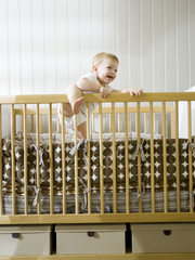 """USA, Utah, Provo, baby boy (18-23 months) standing in crib"""