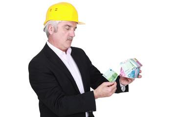 portrait of foreman holding money box