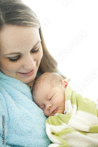 """USA, Utah, Provo, Mother embracing baby boy (0-1 months)"""