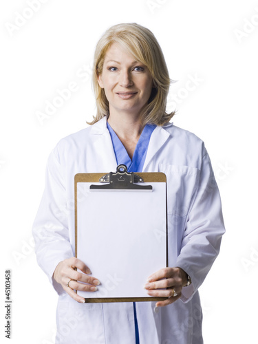 Studio portrait of female doctor holding blank clipboard