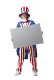 """Man in Uncle Sam's costume holding blank paper, studio shot"""